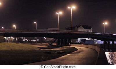 View of bridge and seafront in night city.  Illumination.