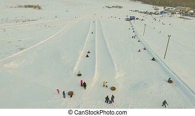 Flight above tne snow tubing track Aerial shot