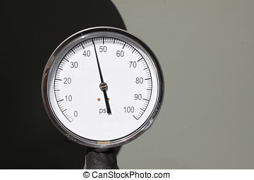 Pressure Gauge - White pressure gauge against a black and...