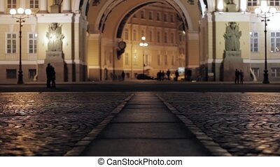 View of Palace square in Saint Petersburg in night. Silhouette of kissing couple