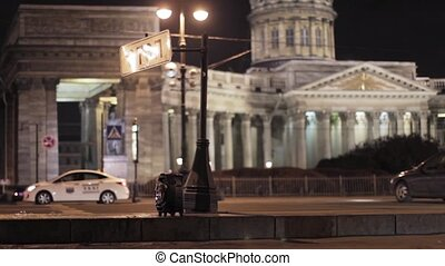 Street with traffic, stop road sign. Kazan cathedral in night focus out.