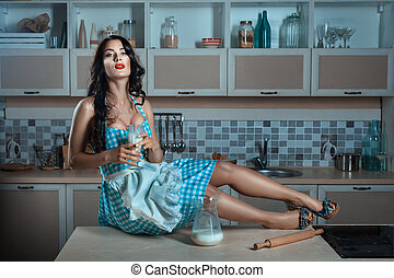 Girl is holding a glass of milk - Girl is holding a glass of...