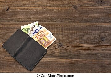 Open Male Black Leather Wallet With Euro Bills On Wood