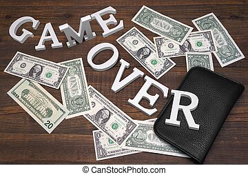 Sign Game Over Dollars And Empty Purse On Wood Background....