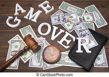 Sign Game Over, Dollars Cash, Judges Gavel On Wood Background