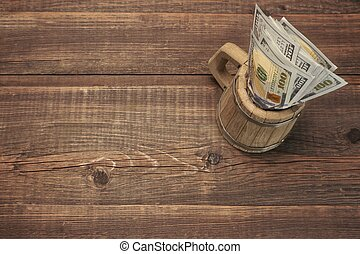 American Dollar Bills In The Wood Bear Mug Top View On The...
