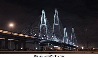 View of motorway huge bridge in night city.  Illumination lights.