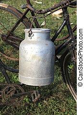 aluminum milk churn used by farmers to bring fresh milk -...
