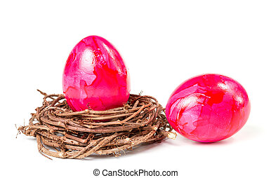 Two Easter eggs in the nest, isolate on a white background