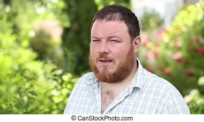 Hoarse, bearded man
