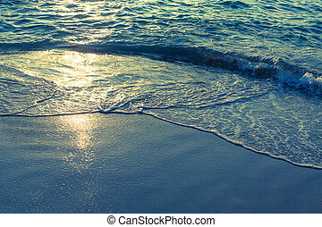 Soft wave of the sea in the rays