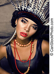 young pretty woman with make up like red indian, fashion...