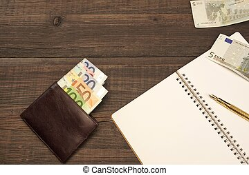 Opened Spiral Notepad, Wallet With Euro Cash, Pen On Wood -...