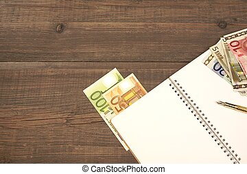 Opened Spiral Notepad And Euro Cash, Pen On Wood - Opened...