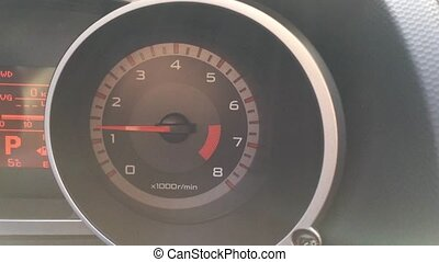 Tachometer showing engine speed of a car. Close up