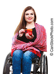 Woman invalid girl on wheelchair holds tea mug - Real...