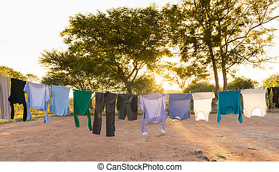 Laundry Drying on Outdoor Clothes Line - Mens and womens...