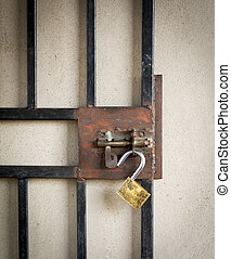 Metal Gate and Open Padlock - Large metal gate and open...