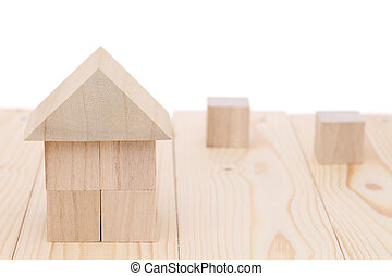 Wooden toy house with natural colored toy blocks