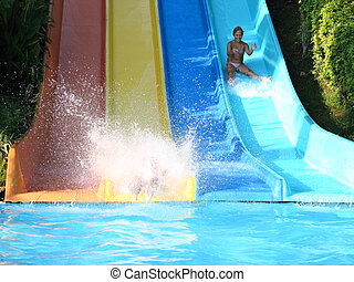 girl sliding with a water slide - sliding girl with a water...