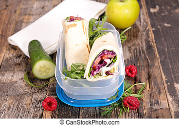sandwich wrap with vegetables and fruits