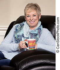 casual mature woman - caucasian middle aged woman sitting on...