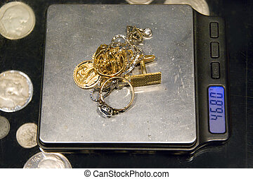 gold jewelry and scale - jewelry on a scales
