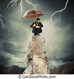 Lonely and desperate businessman - Businessman with umbrella...