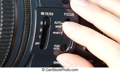 Finger changes video switcher on digital camera, focus -...