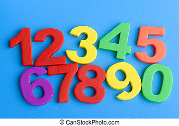 Education numbers on blue - object on blue - toy plastic...