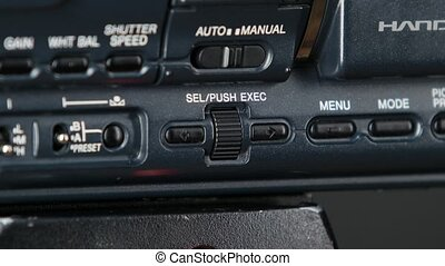 Finger pressing the button on camera, change menu, close up...