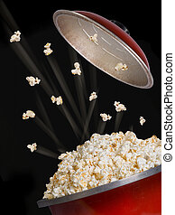 Popcorn Flying - Popcorn flying and exploding from red...