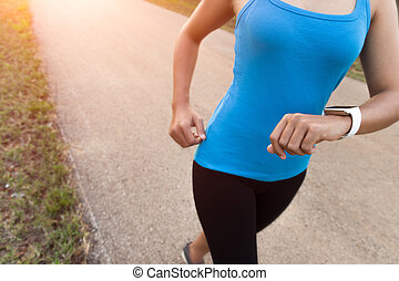 closeup woman running on rural road during sunset