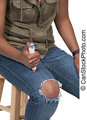Emergency Epinephrine - Woman injecting emergency medicine...