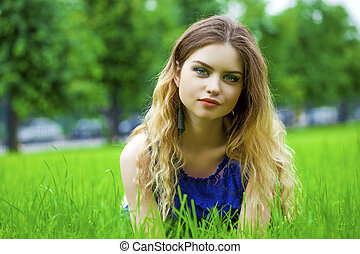 Young blonde woman on green meadow - Sexy young blonde woman...