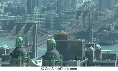 Brooklyn Bridge through a window 1 of 2 - NYC