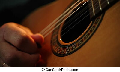 Male hands playing guitar - Guitarists hands playing song...