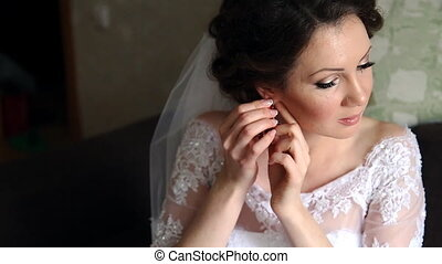 Bride getting ready in the morning in the room - beautiful...