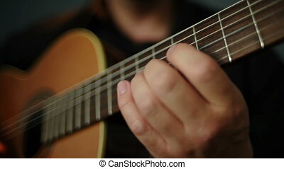 Guitarist plays guitar - Guitarist touches chords with your...