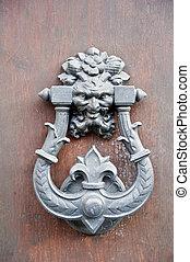 Mediterranean door knocker - Roman metal door knocker on...