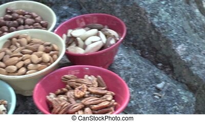 Bowls of mixed nuts outdoors 4 of 4 - Typical scene of food...