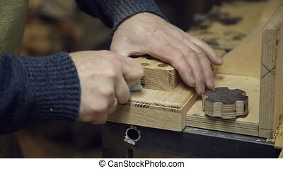 man sandpaper grinds wood - One man sandpaper grinds wood...