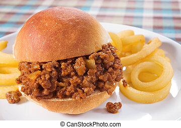 Sloppy Joe - Sloppy joe sandwich served with curly fries.