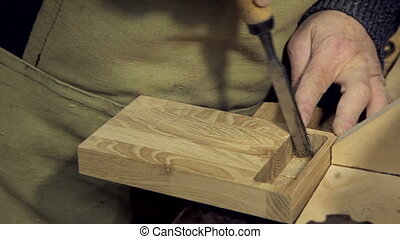 A man works a chisel with a tree HD