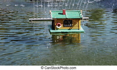 House for ducks in fountain