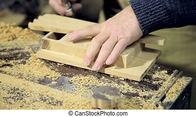 Woodworker Applying Glue to Boards - Closeup of Woodworker...