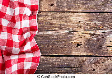 red tablecloth on wooden table - red tablecloth on old...