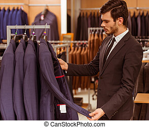 People in suit shop - Modern young handsome businessman...