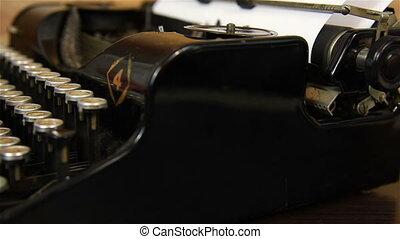 Woman Typing on Vintage Typewriter.