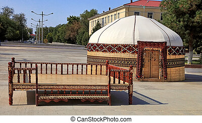 Ethnic nomadic yurt-building and trestle-bed, built for the...